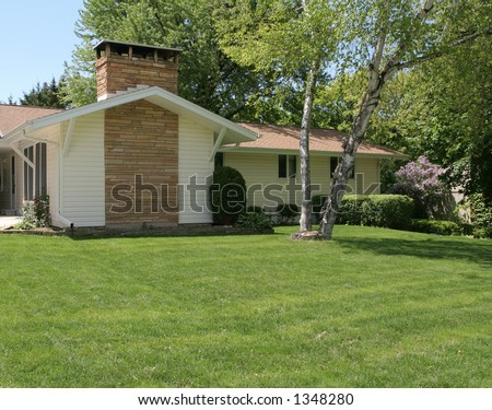 Ranch home front yard - stock photo