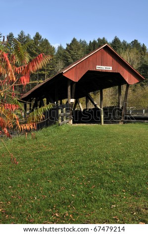Randall Covered Bridge, Lydon, VT with Autumn Sumac in Foreground Vertical and Copy Space - stock photo