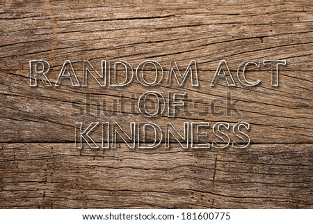 Random Act of Kindness written on wooden background