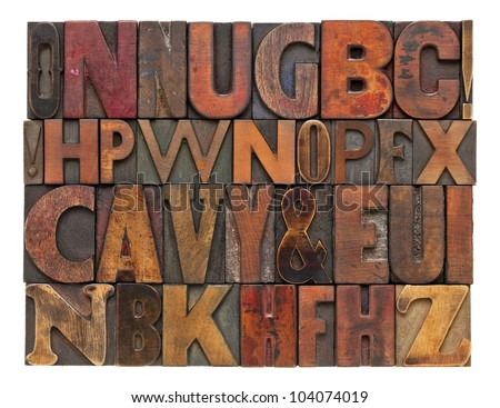 random alphabet letters - vintage letterpress wood type, different size and style of fonts with ink patina - stock photo