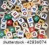 Random array of dice with alphabet letters, of the type typically used in games or to construct words for educational purposes. - stock photo