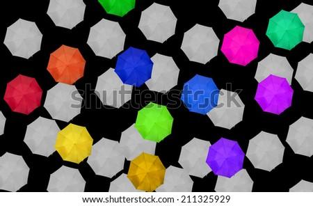 random colored umbrellas with grey on black - stock photo