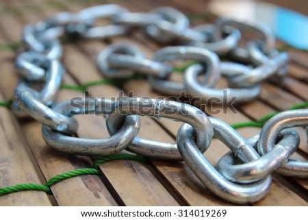 Random Curly Length of  steel chain links - stock photo