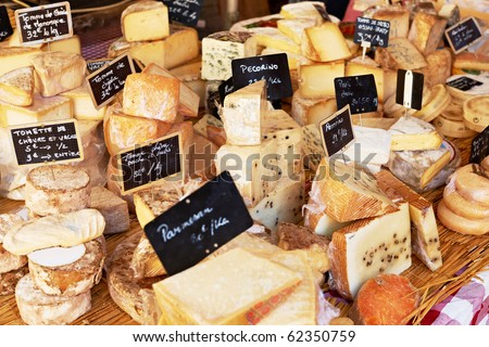 Random French cheese on a market in Provence - stock photo