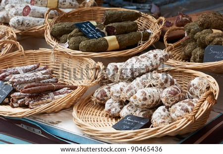 Random home-made sausage at the farmers market in Aix en Provence, France - stock photo