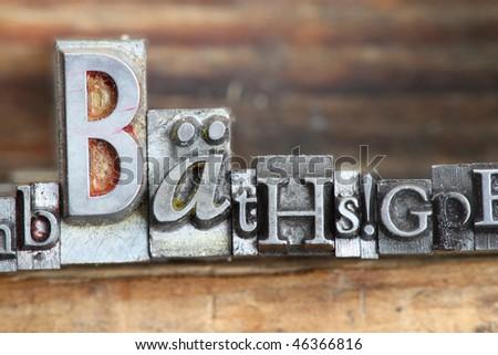 random letters in letterpress type on a wooden background. - stock photo