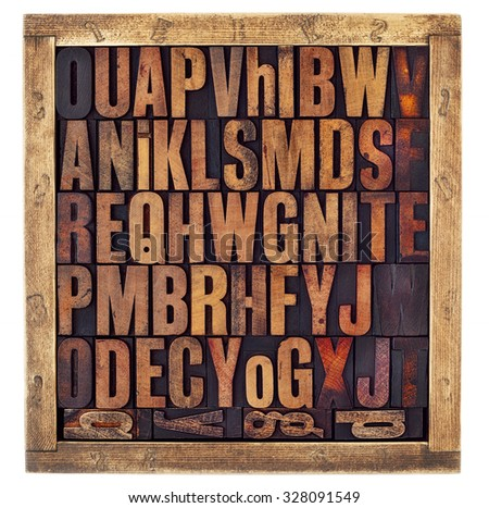 random letters of alphabet - vintage letterpress wood type printing blocks in a rustic box isolated on white - stock photo