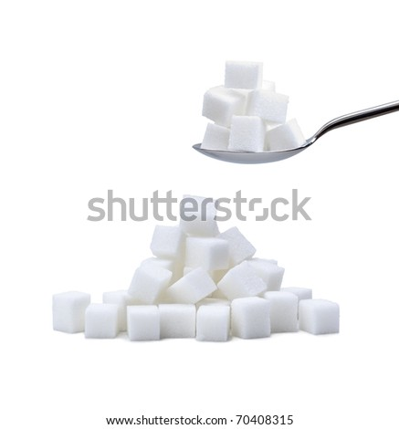 random pile of refined white sugar cubes with a second pile on a steel spoon on white background - stock photo