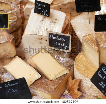 Random sorts of traditional french cheese for sale on rural market ot Provence, South France - stock photo