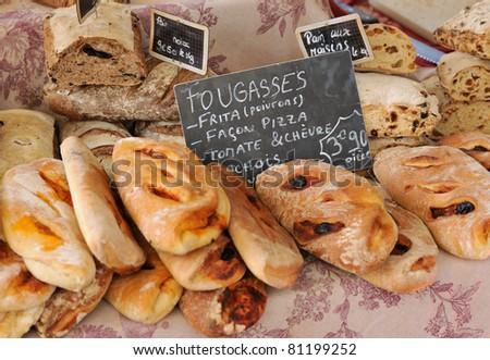 Random types of bread at traditional French Provence market - stock photo
