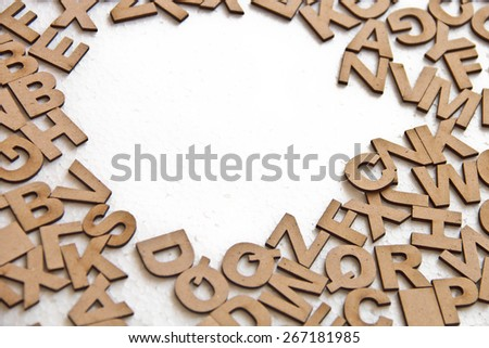 Random Wooden Letterpress Alphabet on white background. Wooden letters are placed like puzzle and for learning the child in school.   - stock photo
