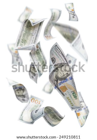 Randomly Falling $100 Bills Isolated on a White Background with Largest Bill in Focus.