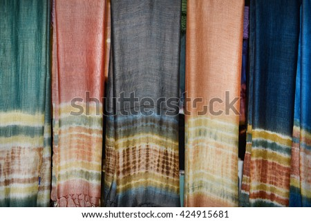 Range of colorful sarongs in the shop - stock photo