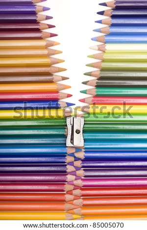 range of colors with pencils forming a zipper