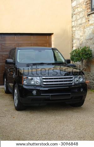 Range Rover Vogue in black - stock photo
