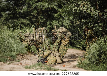 rangers team evacuate wounded comrade from the battlefield