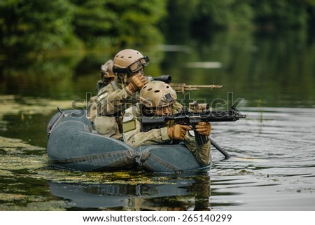 Rangers team ferried by black boat across the river - stock photo