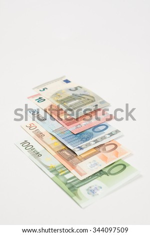 Ranging Euro notes isolated lying - stock photo