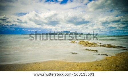 Rangitoto Island from Takapuna Beach  - stock photo