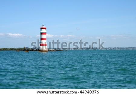 Rangitoto Island Lighthouse Landmark in the Hauraki Gulf, Auckland, New Zealand - stock photo