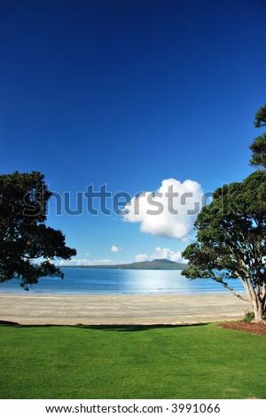 Rangitoto through the pohutakawas, Auckland, New Zealand - stock photo