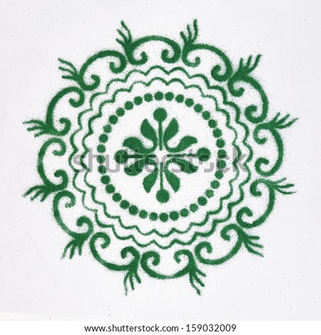 Rangoli- an Indian traditional power drawing - stock photo