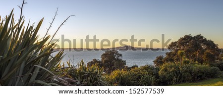 Ranitoto Island/ Rangitoto volcanic island is an icon of Auckland's Hauraki Gulf - stock photo