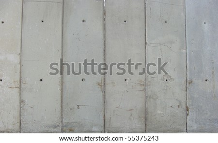 ranked ranged dirty worn industrial large vertical concrete slabs - stock photo