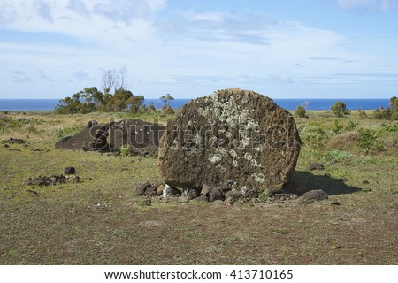 Rano Raraku. Abandoned and partially buried statue on the slopes of the extinct volcano which was the quarry from which the Moai statues of Rapa Nui (Easter Island) were carved. - stock photo