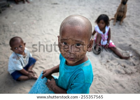 RANONG, THAILAND - FEBRUARY 22: Unidentified Morgan children at fisherman village in Southern Thailand, They are sea-based culture inhabit the coast and islands in the Andaman Sea on Feb 22, 2015.