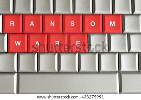 Ransomware written on metallic keyboard in red - stock photo