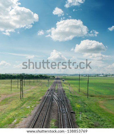 raolroad to horizon and clouds on sky - stock photo