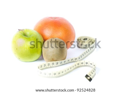 Rape fruits with measuring tape on white background