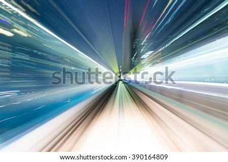 Rapid motion of train at night - stock photo
