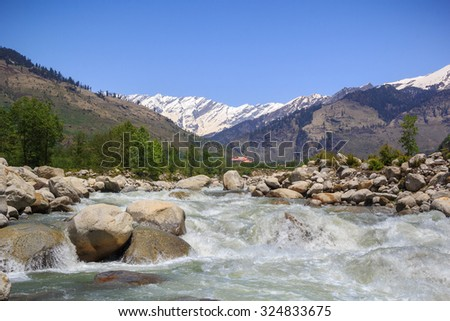 Rapid mountain river Beas, Himachal, India. Its source originates at the pass Rohtang. - stock photo