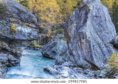 Rapid mountain river through a ravine - stock photo