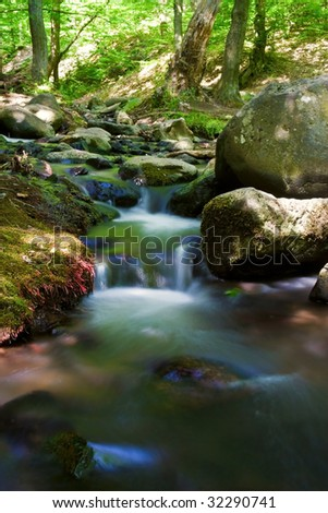 Rapid River Forest rocks in summer. - stock photo