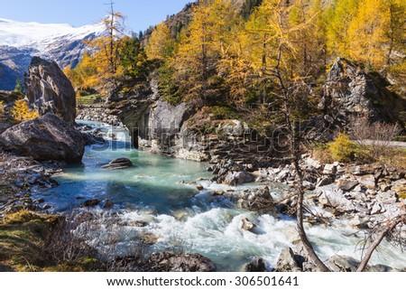 Rapid River in alp landscape - stock photo