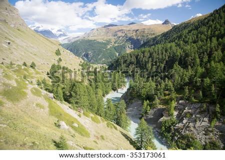 Rapid river in the swiss valley, Zermatt - stock photo