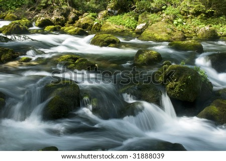 rapids with stones and moss in austria - stock photo
