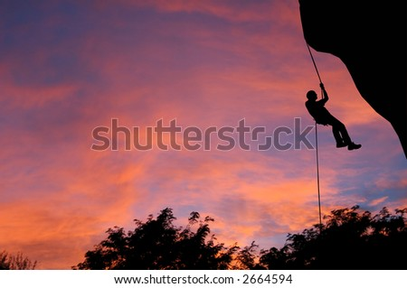 Rappeling at dusk in Montana. - stock photo