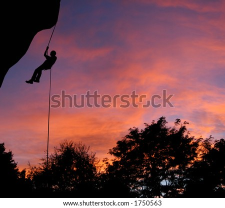 Rappelling at dusk in Montana. - stock photo