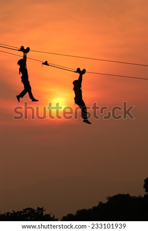rappelling in evening - stock photo
