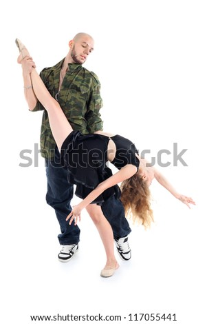 Rapper holds leg and waist of graceful gymnast isolated on white background. - stock photo