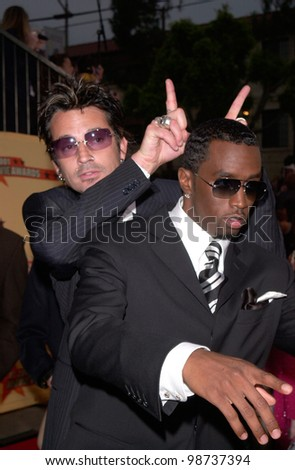 Rapper SEAN PUFFY COMBS aka P. Diddy & rock star TOMMY LEE at the MTV Movie Awards in Los Angeles. 02JUN2001.