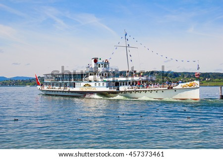 "RAPPERSWIL, SWITZERLAND - AUGUST 17, 2014: Historical steam boat ""Stadt Rapperswil"" departuing for cruise on lake Zurich.Steamboat cruises on the lakes is popluar tourist attaraction of Switzerland"