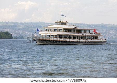 RAPPERSWIL, SWITZERLAND - MAY 10, 2016: MS Helvetia vessel arrives from Zurich to Rapperswill Ferry Terminal. The name Helvetia expresses the female national personification of Switzerland