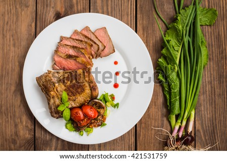 Rare Beef steak medium grilled with barbecue sauce. Wooden table. Top view - stock photo