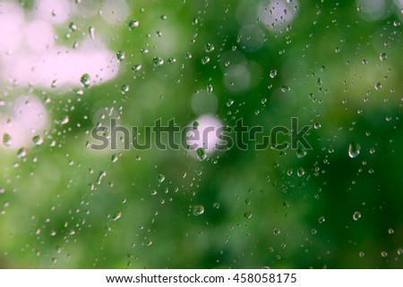 rare drops on a green background, blur glass window, copy space for text. - stock photo