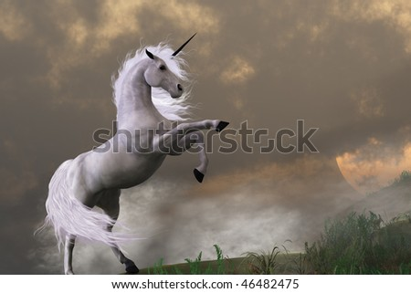 RARE EARTH - A unicorn stag asserts its power on a hill shrouded in clouds. - stock photo